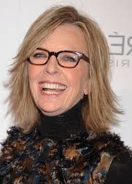 medium layered hairstyle for women over 60 carefree cut with yummy highlights for women over 60 diane keaton