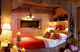 romantic bedroom for couples with wooden frame and red blanket and