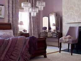 stylish bedroom with purple walls and chair also bedding and using