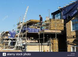 scaffolding to a two new dormer dormers dormas dorm on the