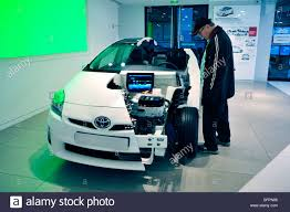 toyota new car dealership paris france man shopping in new car showroom toyota prius