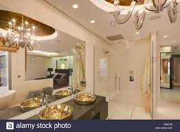 Spanish Bathroom Design by Large Mirror Above Gold Basins In Modern White Spanish Bathroom