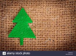 felt christmas decorations on jute background with copy space