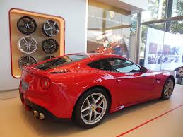 the prancing horse is back in india ferrari mumbai showroom opened