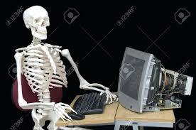 Skeleton Computer Meme - desk 12 a skeleton sits at a desk typing on a laptop computer