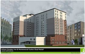dissecting hotel designs in the latest administrative alternates rendering of dual brand hilton garden back of the building