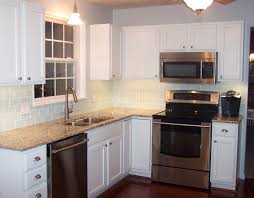 granite countertop white cabinets brown granite dishwasher