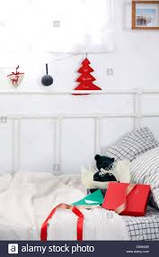christmas ornaments hanging on string and gifts box on couch stock
