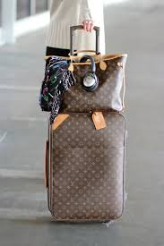Pennsylvania travel purses images Traveling louis vuitton neverfull mm and pegase carryon bag png