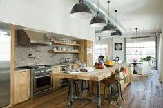 industrial kitchen island industrial meets rustic in this kitchen kitchen design beams