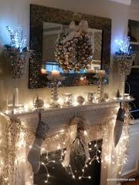 Christmas Decorations For Fireplace Mantel Lights In The Gold And Silver Hurricane Globes Are Topped With Red