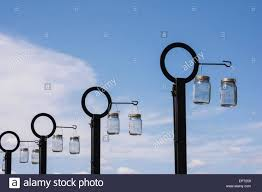 How To Charge Solar Lights - solar lights hanging in the sun to charge stock photo royalty