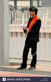 Red Sash Chinese Man With Red Sash Doing Market Research In Guangzhou
