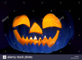 pumpkin blue eyes halloween moody scary dark dramatic orange