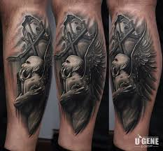 spectacular detailed demonic angel tattoo on leg with cross and