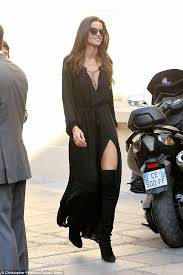 izabel goulart in low cut black dress as she reveals her long legs