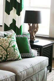 191 best emerald green decor images on pinterest emerald green gorgeous tan green living room design with white green chevron herringbone drapes tan linen slip covered sofa black lattice asian end table and green