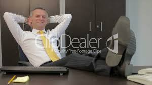 Legs On Desk Happy Relaxed Businessman Smiling In Office Royalty Free