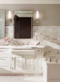 grey beige bathroom traditional with stone tub deck handle roman