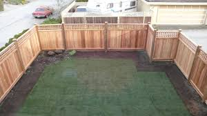 wooden fence with iron in home backyard garden landscape excerpt