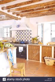 blue white tiled splash back above range oven in spanish country