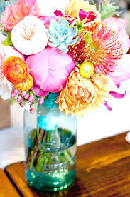 tinted mason jars are perfect for small floral centerpieces mason