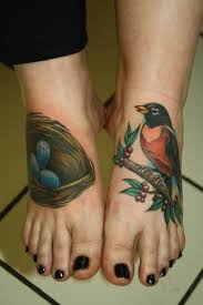 a male robin and his nest by rebecca smith tattoos