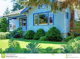 blue old craftsman style house behind the tree stock photo image