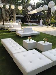 ottomans and cube table bali event furniture rental armadillo