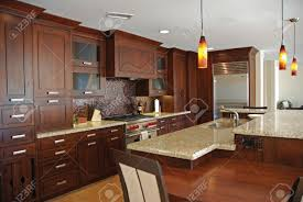 an interior view of an elegant custom built kitchen with wood