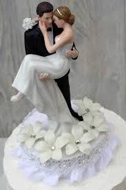 stephanotis groom holding the bride wedding cake topper wedding