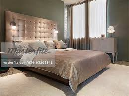 lamps built in to headboard of modern bed stock photo