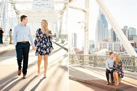 photographers in nashville tn downtown nashville engagement photos at the pedestrian bridge