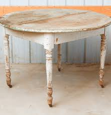round primitive dining table on casters ebth