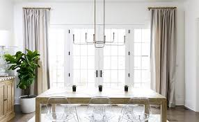 Salvaged French Doors - salvaged wood dining table with clear acrylic molded dining chairs