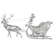 large silver reindeer and sleigh table top sculpture for