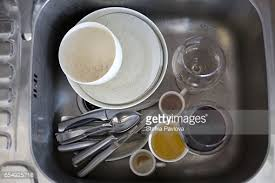 Dirty Dishes Piled In Kitchen Sink Closeup Stock Photo Getty Images - Dirty kitchen sink
