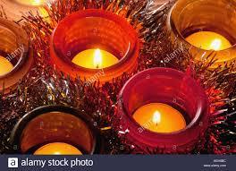 how long do tea lights burn several tea lights burning in coloured glass holders at christmas