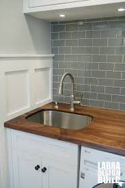 walnut wood countertop with undermount sink on white shaker