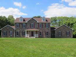 this beautiful stone exterior two story home has an expansive