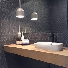 light grey hexagon tile dark grey tiles with contrasting lighter grey grout against light