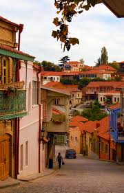 grapes dangle from the balconies of sighnaghi სიღნაღი a