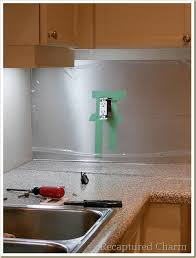 Recaptured Charm Backsplash With The Look Of Stainless Steel - Cutting stainless steel backsplash