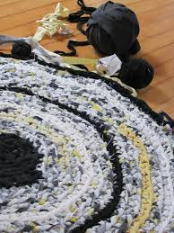upcycled fabric rug in white yellow black and gray made with a