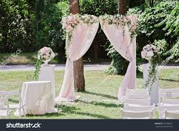 arch wedding ceremony decorated cloth flowers stock photo