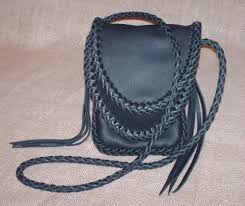 small leather bags w braided seams straps etc and brass zippers