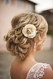 counrty wedding hairstyles for 2015 weddbook sleek wedding wavy curly bun updo wedding