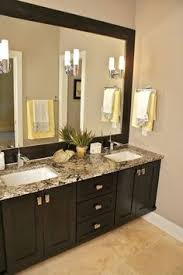 Master Bathroom Mirrors by One Big Mirror Redesigned Into Two Without Replacing The Mirror