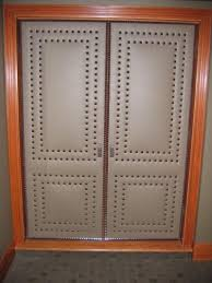 Nailheads For Upholstery These Upholstered Doors Are Executed With Precision Detailing