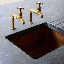 stunning hammered copper sink and aged brass u0027mayan u0027 taps by devol